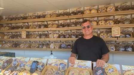Andrew hives inside his Giant Cookie store.