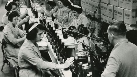 Hard at work on one of the many production lines at the Colman's factory, c1960. Picture: Archant li