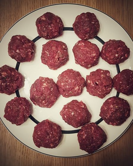 A pate of venison meatballs, uncooked, photographed from above