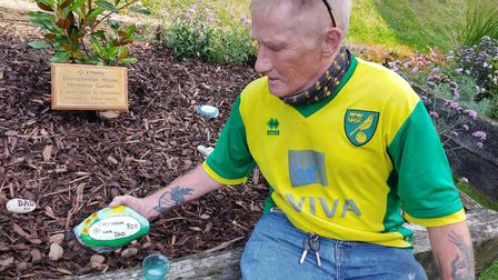 St Martins resident Wayne, laying a stone in memory of his late daughter Carrieanne