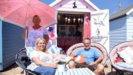 Gwen Smith enjoying the sun at her beach hut, with friends Eleanor and Anthony Mayston
