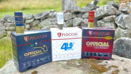 Fiocchi 4HV Sporting, Official Rossa 24g Trap and Fiocchi Official 24g cartridge boxes lined up against a stone wall