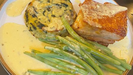 Pork bellywith a side of bubble and squeak, green beans and apple cider sauce