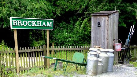 Brockham sign with milk churns and shed