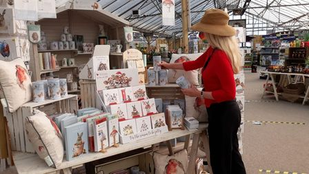 Sally Toro is busy setting up the Christmas giftware section as Sprowston Garden Centre