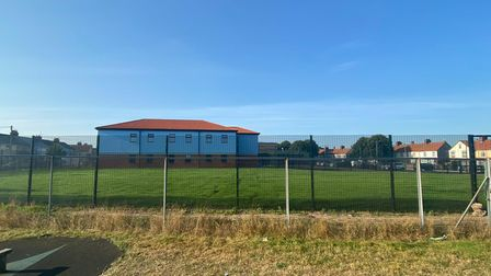 The view of the school field from Fisher Avenue.