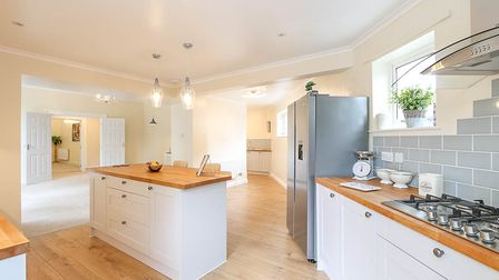 A second shot of the kitchen in the property in Stafford Place, Weston, with central island, silver American fridge and hob
