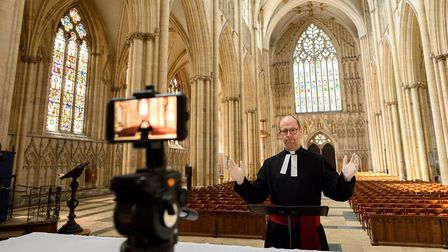 York Minster's Canon Pastor, Reverend Michael Smith rehearses the weekly broadcast of the Minster's