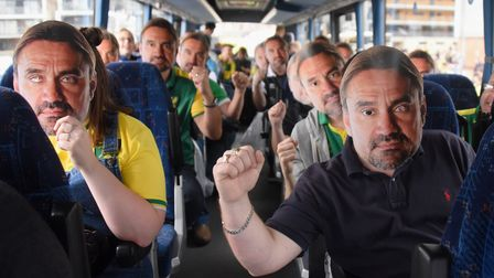 Norwich City football fans wearing their Daniel Farke masks on one of the coaches bound for the Emir