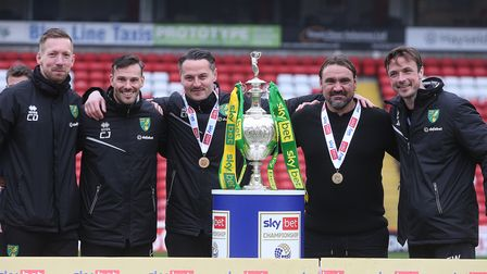 Norwich Head Coach Daniel Farke and his management team with the EFL Championship trophy at the end