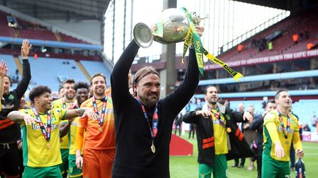 Norwich Head Coach Daniel Farke with the trophy at the end of the Sky Bet Championship match at Vill