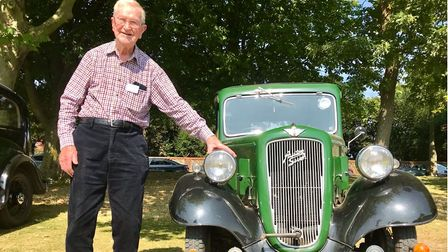 A 95-year-old man, Ron Low, next to his 1935 Austin Seven