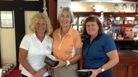 Lady Captain Mo Kendall presenting Linda Reynolds and Rosemary Norrish
