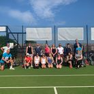 Those who took part in the cardio-tennis demonstration with coach Gary Howe, kneeling left.
