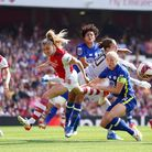 Arsenal's Leah Williamson challenges for the ball during the FA Women's Super League match at the Em