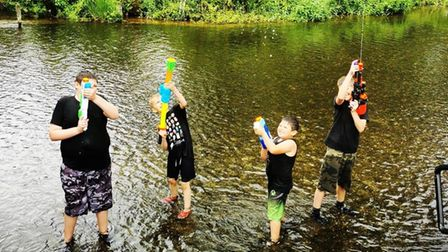 Enjoying a water fight in Earlham Park on a Twinkle's day out