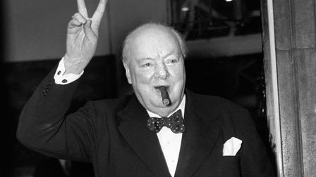 Sir Winston Churchill gives his familiar 'V' sign after a lunchtime meeting with American Secretary