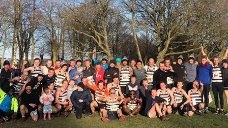 Highgate Harriers men celebrate their Met League title double in 2020, with captain Rob Wilson (fron