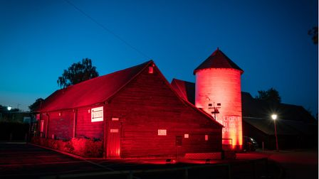The Barn Theatre in Welwyn Garden City lit up at night.