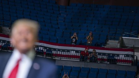 President Donald Trump supporters cheer as Trump speaks during a campaign rally at the BOK Center in