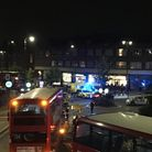 A woman was taken to hospital after being hit in a police chase in Muswell Hill