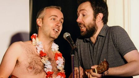 Hitchin Mostly Comedy's David Ephgrave and Glyn Doggett on stage.