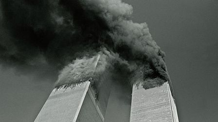 September 11, 2001 - New York, New York, U.S. - Smoke billows from the twin towers of the World Trad