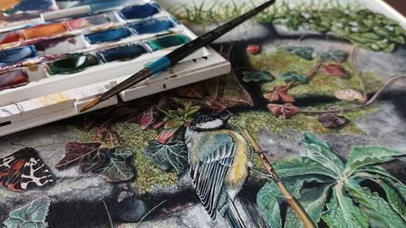 Handpainted great tit, by Rebecca Christian, with watercolour paint palette alongside