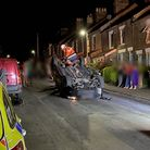 A woman has been arrested after her car flipped and crashed into three others on Churchill Road in Norwich.