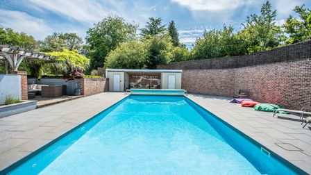 The home even comes with an outdoor swimming pool