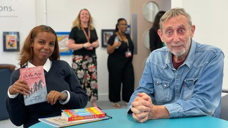 Michael Rosen with a pupil at the library opening of Haringey Learning Partnership