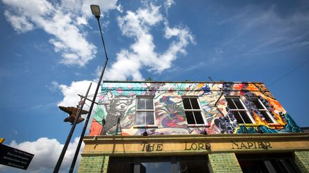 New artwork by local artists can be seen on the graffiti-clad building.