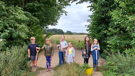 Children joined forces with the Alconbury Brook Flood Group to plant trees.