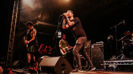 Frank Turner joined NOFX during their set onthe Punk in Drublic stage at Slam Dunk Festival South in Hatfield Park.