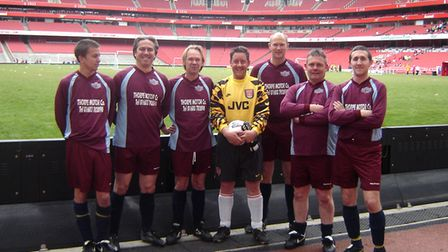 Seven members of the Norfolk Arsenal Supporters Club playing in a seven-a-side supporters club tournament at the Emirates.