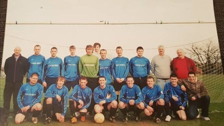 Local football stalwart Chris Bailey is pictured on the far right of the back row