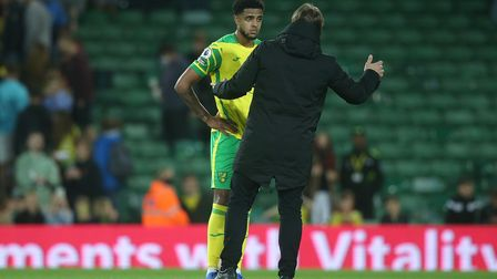 Canaries head coach Daniel Farke gave Andrew Omobamidele a quick coaching session after the 5-0 win