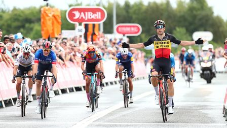 Wout van Aert (right) beats Julian Alaphilippe (left) and Ethan Hayter (second right) on stage six of the Tour of Britain.