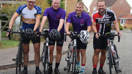 Rob Aldred, second right, ready for his 160 miles cycle ride to Sheffield, with his friend, Scott Ra