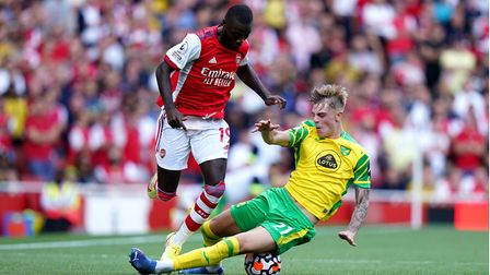 Arsenal's Nicolas Pepe (left) and Norwich City's Brandon Williams battle for the ball during the Pre
