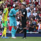 Tim Krul leads the Norwich City protests following Arsenal's winner