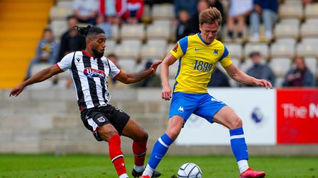 Armani Little of Torquay United battles for the ball with Erico Sousa of Grimsby Town during the Nat