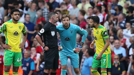 Norwich City keeper Tim Krul gets an explanation from Michael Oliver following Arsenal's match-winning goal