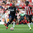West Ham United's Michail Antonio and Southampton's Mohammed Salisu battle for the ball during the P