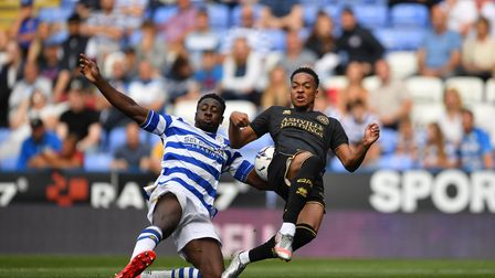 Reading's Andy Yiadom (left) and Queens Park Rangers' Chris Willock during the Sky Bet Championship