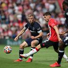 West Ham United's Jarrod Bowen and Southampton's Romain Perraud chase the ball during the Premier Le