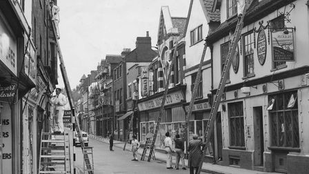 Norwich - Streets - SPainters are at work on the exterior of The Plough owned by Youngs and