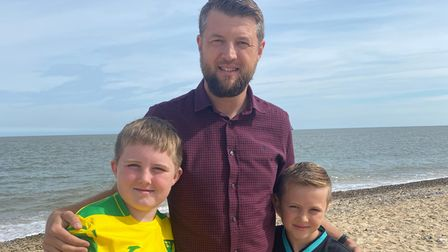 Chris Hall with his two sons on Gorleston beach.