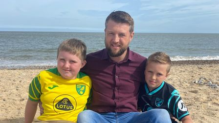 Chris Hall on Gorleston beach with his two sons.