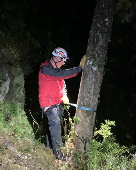 A volunteer helping to rescue Alexander Capp out of a Welsh gorge